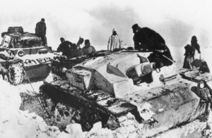 German troops not only battled the Soviets but also the cruel elements as well. Here, a German tank drags an immobilized assault gun from a snowdrift.