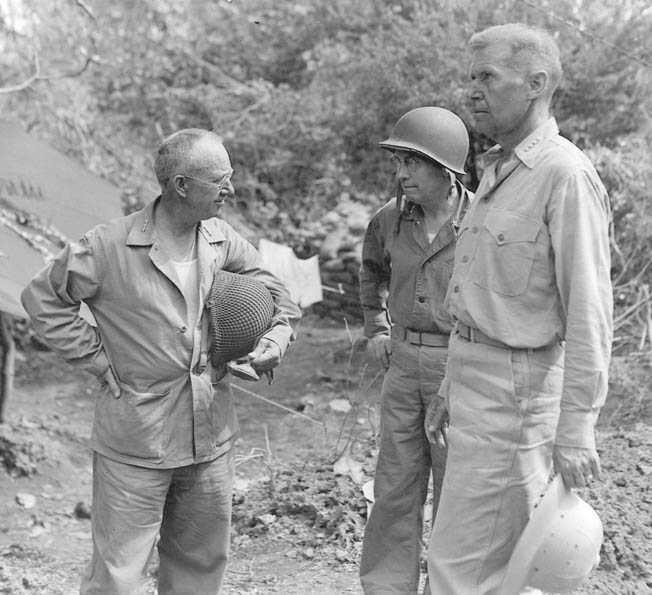 Left to right, U.S. Marine General Holland M. Smith, commander of the V Amphibious Corps, Marine Major General Thomas G. Watson, commander of the 2nd Division, and Admiral Raymond Spruance, commander of U.S. naval forces in the Philippine Sea, confer during operations in the Marianas.