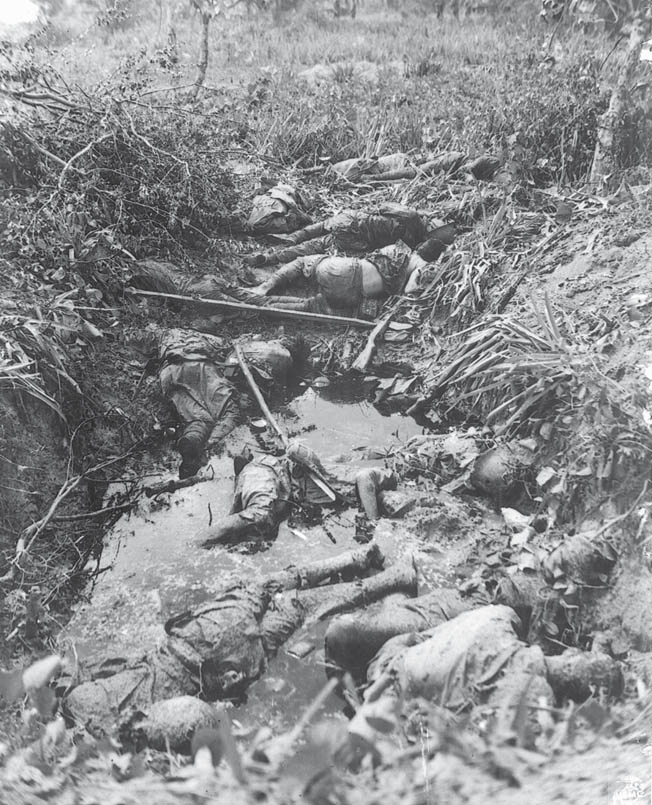 Lying heaped in a shell hole, a large number of dead Japanese soldiers have yet to be buried. The Japanese regularly fought to the death on Saipan, perishing in pitched banzai charges or at the hands of American troops determined to capture the island despite the heavy resistance.