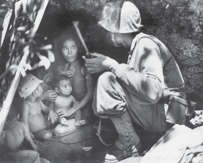 A U.S. Marine tries to communicate with a Japanese family he has discovered hiding on Saipan. The Japanese civilians had been warned of American brutality by their own propagandists. Tragically, many of them chose suicide rather than surrender to American forces.