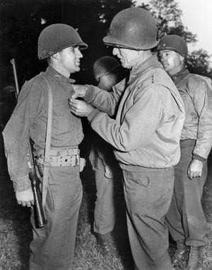 U.S. Ninth Army commander Lt. Gen. William Simpson presents Major George Mabry with the Distinguished Service Cross for his exploits on D-Day. He would also be awarded the Medal of Honor for his courageous leadership during the Hürtgen fighting.
