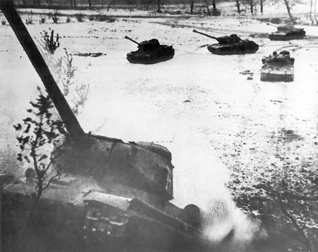Heavy tanks of the Red Army advance across a snow-covered valley and up a hill in East Prussia on February 17, 1945. Within weeks, Soviet armor was in the streets of Berlin.