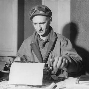 Stationed at his manual typewriter, Ernie Pyle bangs out a column near the front line at Anzio, March 18, 1944. Pyle wrote some of the most insightful and poignant reports during the Italian campaign.