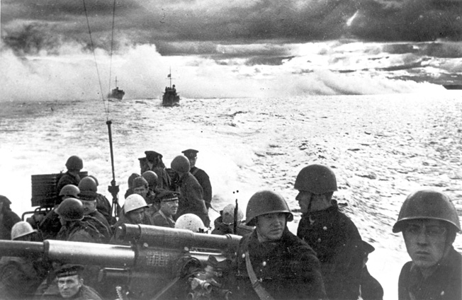 Soviet marines prepare to embark on a raid against German positions. When Axis forces occupied Novorossiysk on the Black Sea, the Soviet Navy was deprived of a principal base.