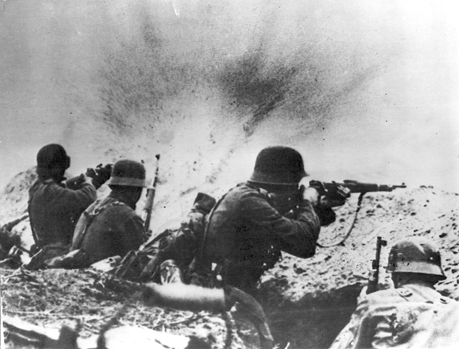 In the heat of combat, German soldiers crouch and fire their weapons feverishly from a trench line as Soviet marines advance against them.