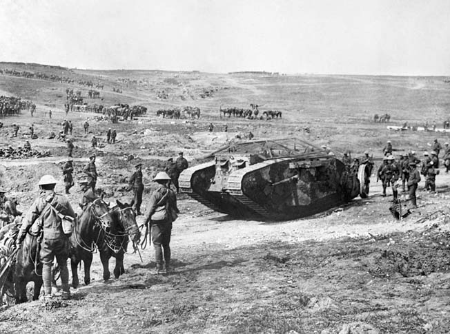 "This Mark IV, nicknamed ""Clan Leslie,"" is seen in Chimpanzee Valley on September 15, 1916, the day the tanks first went into operation. A total of 1,220 Mark IVs were built by the end of World War I: 420 males, and 595 females."