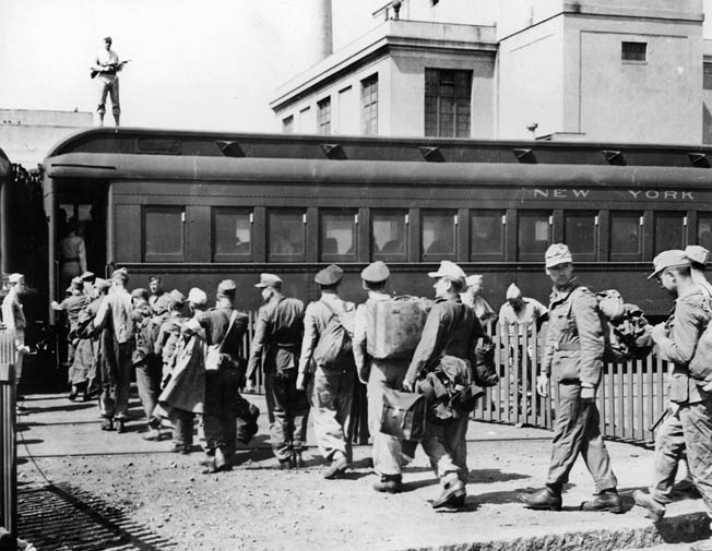 German POWs, still in their uniforms, board a train in Boston en route to a prison camp. About 425,000 German prisoners of war were held in 700 camps in 46 states. There were also camps for Italian and Japanese prisoners. Overall, POWs in the U.S. were well-treated and well-fed.