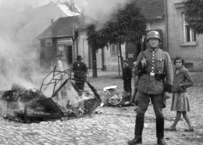 The Poles were frequent targets of German brutality during World War II; however, the occupiers saved their most horrific actions for the Jews. In this poignant photo, furniture taken from a Jewish home is burned in the street in the town of Myslenice.