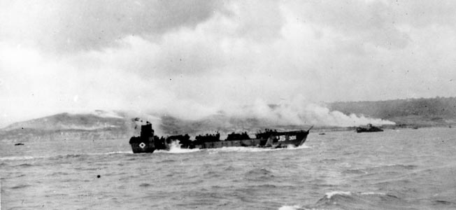 A Landing Craft Mechanized (LCM) races for the beach. The LCM Watson rode in hit a mine and sank nearly 300 yards from Omaha Beach.
