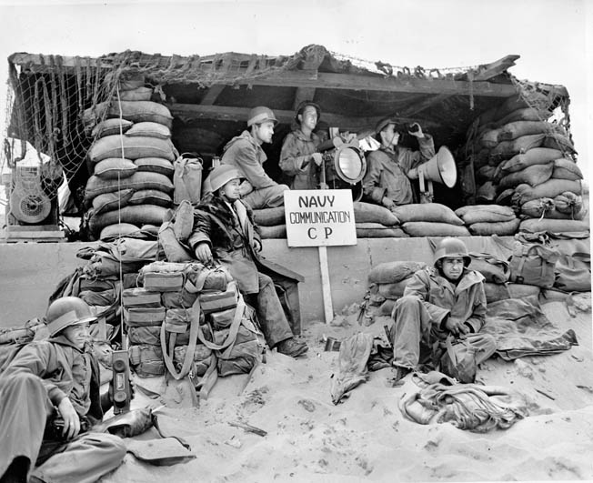 Just one of the many Navy communications command posts on the Normandy beaches. Sailors used signal lights, flags, and radio communication to keep supplies arriving to the troops as they were needed.