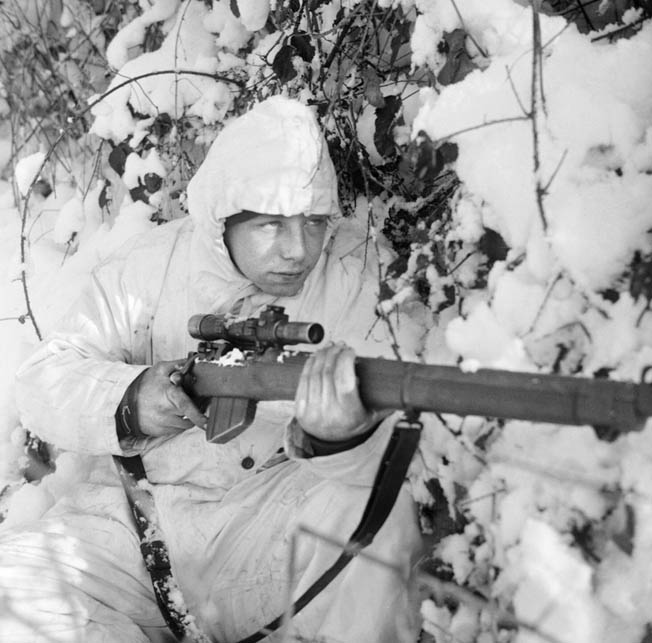 A British 6th Airborne Division soldier uses a SMLE No. 4 (T) sniper model with a scope during the Battle of the Bulge.