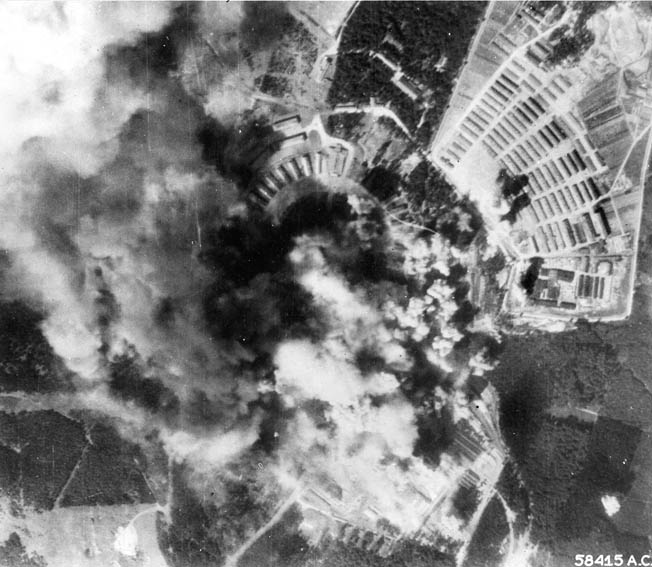 Aerial photo of Buchenwald during the bombing on August 24, 1944, one of the most precise strikes of the war. The factory is shrouded in a pall of smoke. Prisoner barracks, at upper right, were virtually untouched.
