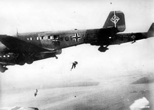 German paratroopers leap from their transport planes during an airborne assault. Airborne forces suffered heavy losses during the Holland portion of Fall Gelb.