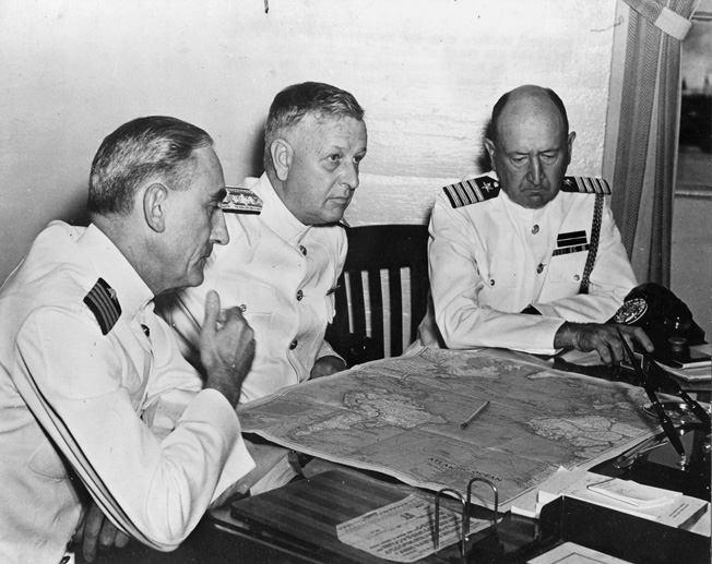 Admiral Husband E. Kimmel, USN, center, confers with his operations officer, Captain W.S. Stanley (left) and his chief of staff, Captain William W. Smith.