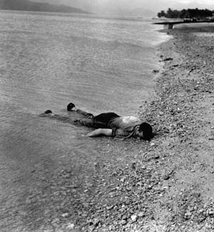 A bluejacket killed during the Japanese attack lies on the beach at Kaneohoe.