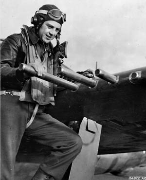 Colonel Hubert Zemke, commander of the famous U.S. 56th Fighter Group in Europe, examines one of the .50-caliber machine guns placed in the wings of his P-47 Thunderbolt fighter.