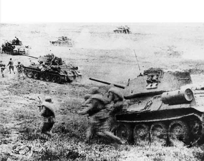 Soviet T-34 medium tanks and accompanying infantry charge across open ground during the epic Battle of Kursk in the summer of 1943. Soviet armored doctrine required that Red Army tanks close rapidly with the enemy to negate the outstanding range of the heavy 75mm and 88mm guns that equipped German tanks.