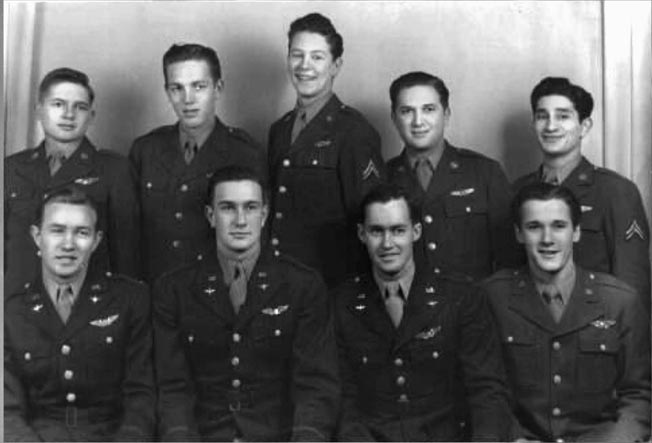 The crew that rode Skyway Chariot on its fateful day. Front Row (L to R): John Spencer, pilot Rollie King, Jack Williams, Ray Wilding. Back Row: Robert G. Mitchell, Francis Gordon, James Baker, Meyer Gitlin, Archie Mathosian.