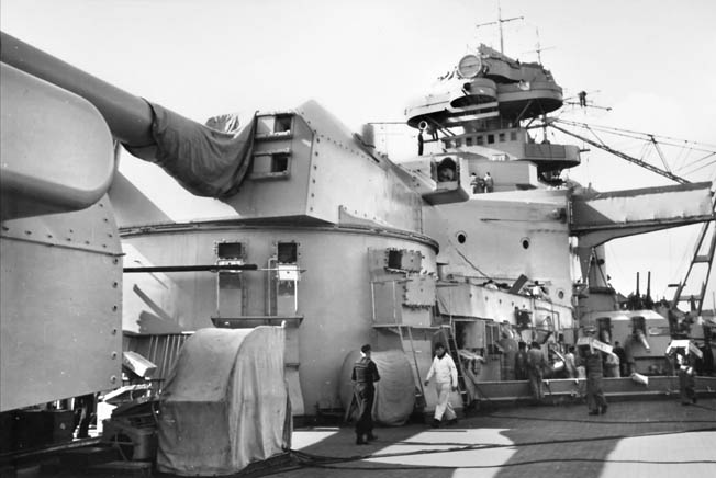 One of Bismarck's 15-inch gun turrets, this one named Bruno, looms above the deck as  sailors go about their business. Under close scrutiny, the broadside punch of the battleship's heaviest weapons was only average among the warships of other nations.