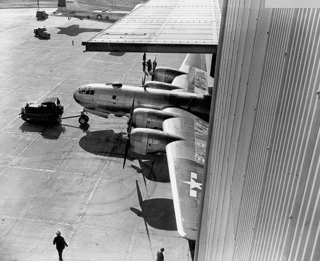 A tug tows the first completed B-29 out of the Marietta facility for its initial test flight, November 1943.