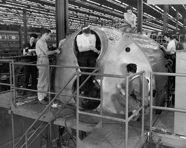 A crew of men and women work on the pressurized cockpit section of one of the big bombers in 1944. More than 600 of the 3,970 B-29s were produced at the Marietta factory which, now owned by Lockheed Martin, still produces aircraft for the U.S. Air Force.