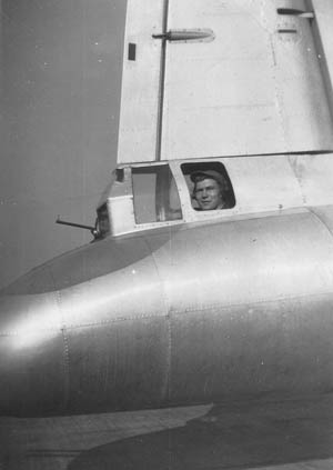 "Wilbur ""Bib"" Bowers survived 30 missions in a Boeing B-17 Flying Fortress bomber during World War II. The average service expectancy of an American bomber crewman was significantly shorter. Bowers is shown in this photograph in the tail gunner position aboard a B-17. The small barrel protruding in front is the sight. The actual twin .50-caliber machine guns were positioned below him."