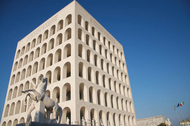 """The repetitive arches of the Palazzo della Cività Italiana, popularly called the """"Square Coliseum"""" (today an office building), have been used as a backdrop in several Italian feature films."""
