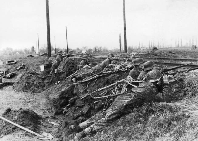 SS Panzer Grenadiers and police units fought side-by-side in Hungary during the spring offensive. By the time the roads began to dry out in mid-March, German panzer forces participating in the offensive had shrunk to 50 percent of their ini- tial strength, making further gains unlikely.
