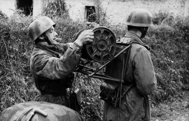 Communications were an essential part of the German defense system in Normandy. These signalers are laying wire for field phones, but they also must repair those lines cut by French Resistance fighters.