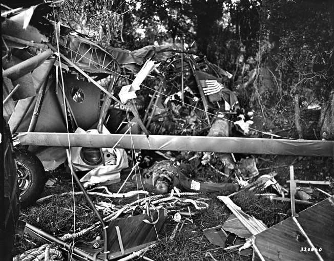 An American lies dead in the wreckage of his glider after crashing near Carentan on June 7. Members of Fallschirmjäger 6 ambushed many of the gliders as they landed.