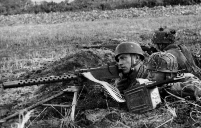The Fallschirmjäger often used captured weapons in the defense of Normandy. This gun crew is using an American .30-caliber Browning air-cooled machine gun.