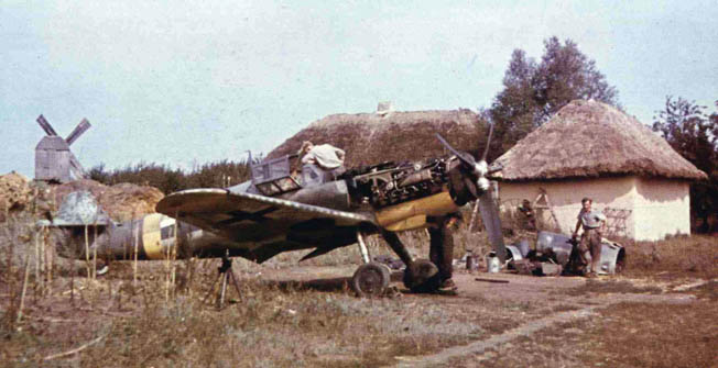 In this rare color photograph, an aircraft believed to be an Me-109 of JG 52 undergoes repairs somewhere in Russia. German maintenance crews struggled mightily to keep their planes in the air due to shortages in spare parts and fuel.