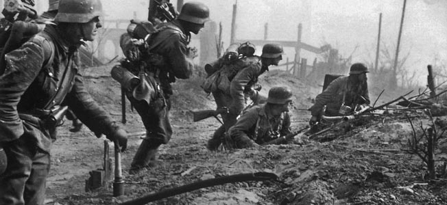 Surrounded by destroyed buildings, a German heavy mortar crew follows infantry during fighting in Stalingrad. Hitler refused to allow the Germans to give up the city once it was surrounded by the Russians.