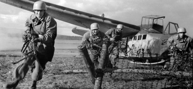 Fallschirmjägers exit a DFS 230 glider during training. This type of glider was used during the assault on Belgium's Fortress Eben-Email and the invasion of Crete.