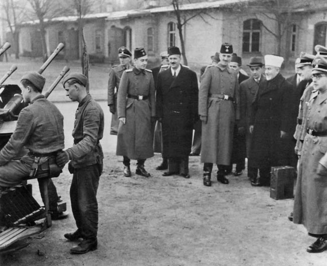ABOVE: Haj Amin Al-Hussaini, Grand Mufti of Jerusalem, confers with Hitler in Berlin in December 1941. The Mufti courted German support for the Arab cause but never received the tangible military support he sought. LEFT: In a show of force, the British Scots Guards parade in Palestine during the Arab Revolt of 1936.