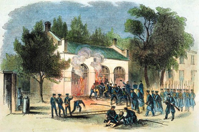 Marines led by Lieutenant Israel Greene storm the engine house at Harpers Ferry, Virginia, where terrorist John Brown was holed up.