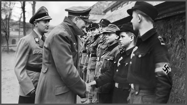 In a still taken from a German newsreel, Adolf Hitler awards medals to members of the Hitler Youth in Berlin on his 56th birthday, April 20, 1945. Ten days later, the Führer, who vowed never to give up, would be dead by his own hand.