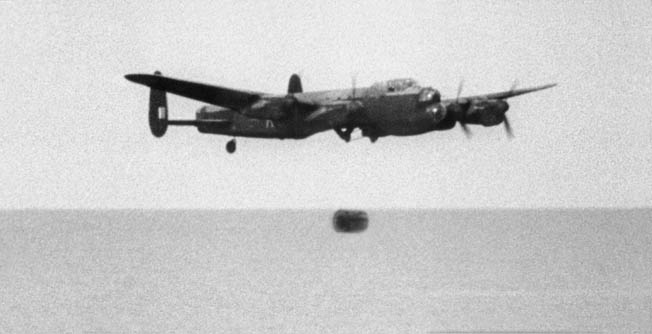 A Lancaster releasing its dummy Upkeep bomb into a lake at Reculver bombing range, Kent.