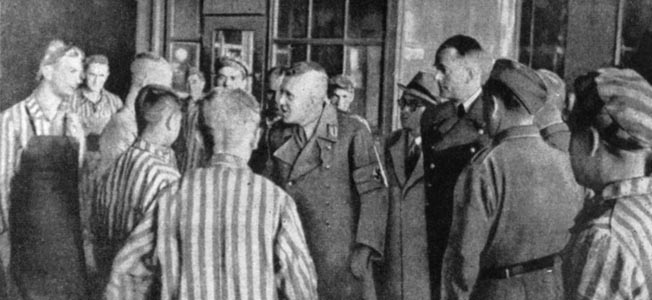 """The only image of Speer (fourth from right) visiting a concentration camp (Mauthausen). Speer claimed not to know about the existence of Hitler's """"Final Solution."""""""