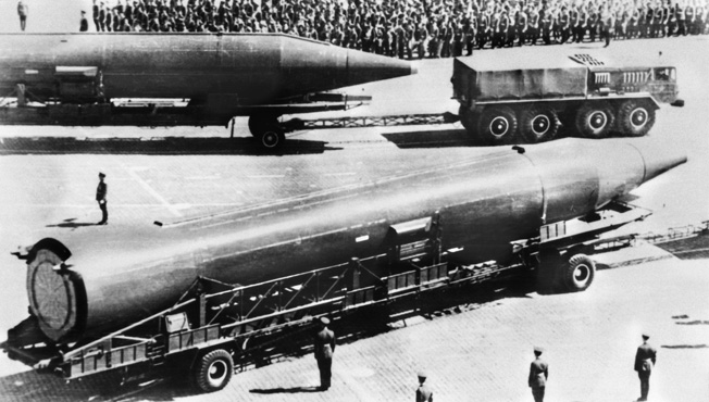 A right side view of two vehicle-mounted Soviet SS-5 Skean intermediate-range ballistic missiles.