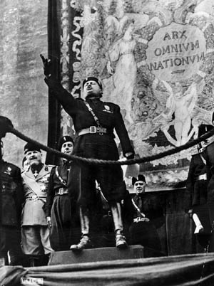 Italian leader Benito Mussolini, shown here exhorting his followers, believed that modern fascist architecture should make the people feel subordinate to the power of the state.