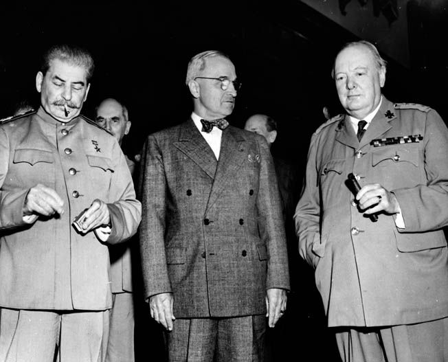 "Stalin, Truman, and Churchill at the Potsdam Conference, July 1945, where Truman, bouyed with the news of the successful test, reportedly told Stalin ""where to get off."""