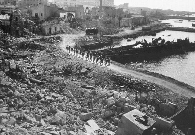 infantry landed at Pantelleria's destroyed harbor without opposition, June 11, 1943.