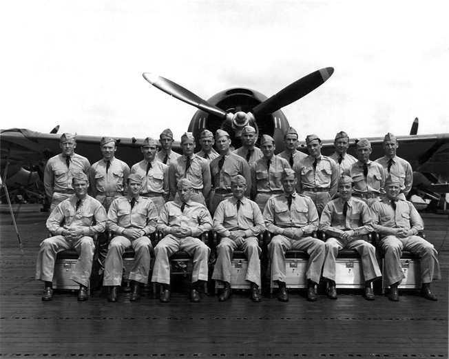 Pilots and crewmen from Scout Squadron Six pose for a group photo. Several of these airmen fell victim to friendly or enemy fire during the attack on Pearl Harbor.