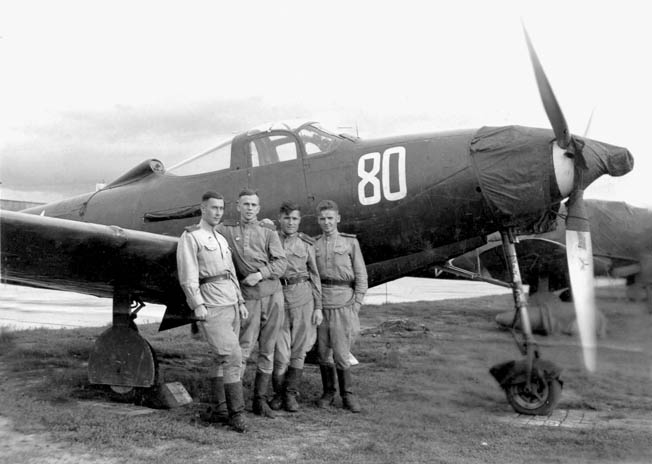 Several Red Air Force pilots stand with a Bell P-39 Airacobra fighter plane. The P-39 was supplied by the United States through Lend-Lease, and though it was a disappointment in most dogfighting scenarios it proved a robust ground attack aircraft.