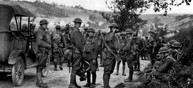 Doughboys in the 28th Infantry Regiment, 1st Division, carry M1903 Springfields near Soissons, France, in 1918.