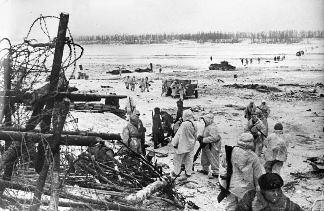 The 900-day German siege of the great city of Leningrad was raised at the end of January 1944. In this photo, Red Army soldiers congregate along the banks of the Neva River near the city and shortly after the German grip was broken.