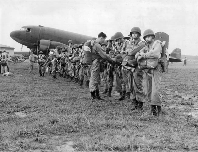 During ceremonies at Fort Benning, Georgia, 20 enlisted men and two officers of the 1st Canadian Parachute Battalion receive their coveted silver wings, which designate them as qualified jumpers and graduates of the U.S. Army parachute school.