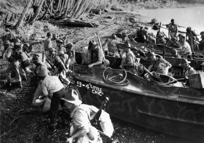 British soldiers exit a landing craft and head into the thicket on a mission to relieve their American allies.