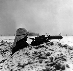 Scanning the horizon down the barrel of his .30-caliber machine gun, this soldier from the 30th Infantry Division watches for signs of enemy movement.